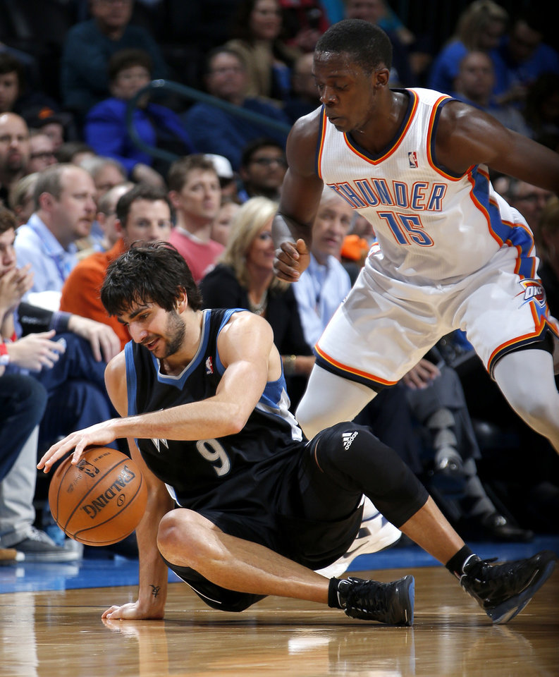 Photo - Oklahoma City's Reggie Jackson (15) defends Minnesota's Ricky Rubio (9) during an NBA basketball game between the Oklahoma City Thunder and the Minnesota Timberwolves at Chesapeake Energy Arena in Oklahoma City, Wednesday, Jan. 9, 2013.  Photo by Bryan Terry, The Oklahoman