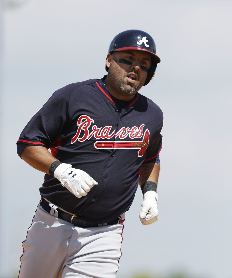 Photo - Atlanta Braves' Gerald Laird rounds third base after his two-run home run during the sixth inning of a spring exhibition baseball game against the Detroit Tigers in Lakeland, Fla., Tuesday, March 25, 2014. (AP Photo/Carlos Osorio)