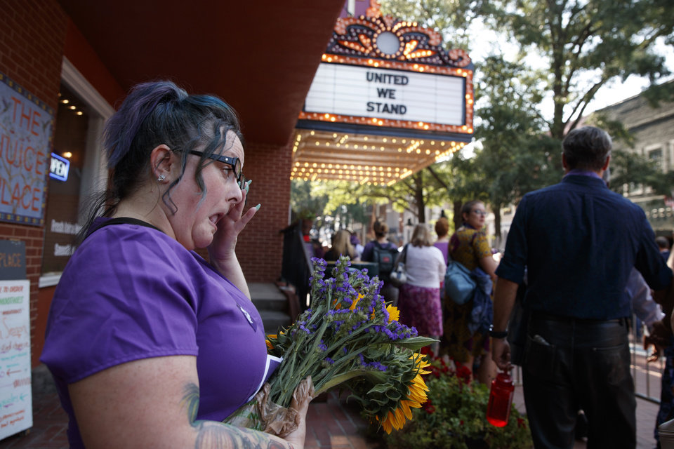 Photo - Cynthia Sullivan of Charlottesville, Va., stands in line for a memorial service for Heather Heyer, who was killed during a white nationalist rally, Wednesday, Aug. 16, 2017, in Charlottesville, Va. (AP Photo/Evan Vucci)