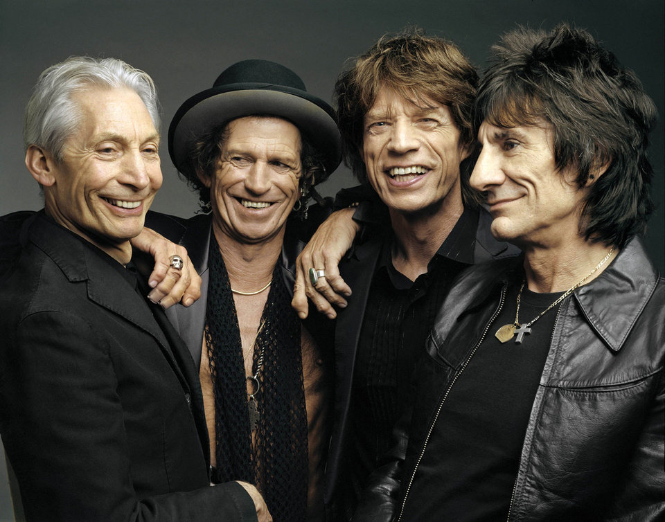 """Photo - FILE - This 2005 file photo, originally supplied by the Rolling Stones, shows members of the group, from left, Charlie Watts, Keith Richards, Mick Jagger, and Ron Wood posing during a photo shoot.  The Rolling Stones have called off their tour dates in Australia and New Zealand following the death of Mick Jagger's girlfriend and designer L'Wren Scott on Monday, March 17, 2014. The iconic band says in a statement Tuesday they """"are deeply sorry and disappointed to announce the postponement of the rest of their 14 ON FIRE tour."""" (AP Photo/The Rolling Stones, Mark Seliger-File)"""