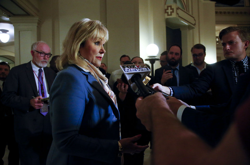 Photo - Governor Mary Fallin speaks to the media about her disappointment on the failure of HB1054 and a state budget resolution after the conclusion of a special session at the Oklahoma State Capitol in Oklahoma City on Wednesday Nov. 8, 2017. JESSIE WARDARSKI/ Tulsa World