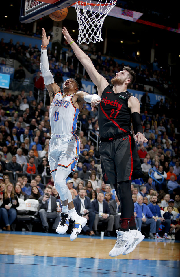 Photo - Oklahoma City's Russell Westbrook (0) goes up for a lay up as Portland's Jusuf Nurkic (27) defends during the NBA basketball game between the Oklahoma City Thunder and the Portland Trail Blazers at Chesapeake Energy Arena in Oklahoma City, Tuesday, Jan. 22, 2019. Photo by Sarah Phipps, The Oklahoman