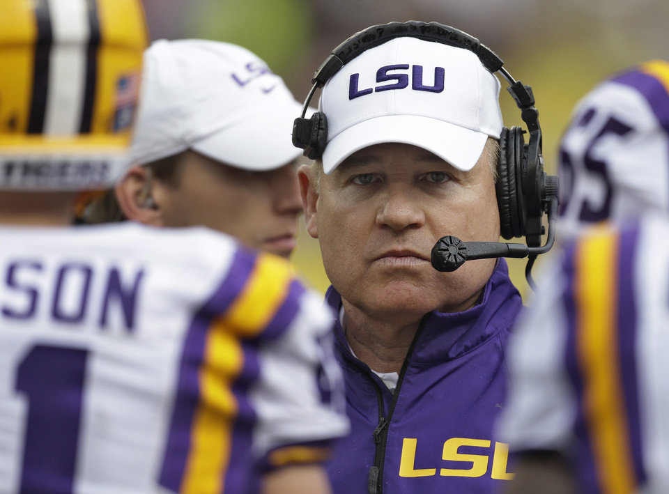 Photo -   LSU     * Coach:  Les Miles    * 2013 model:  5-3 SEC record not up to Bayou standards    * Strengths:  Four offensive line starters return, and you know how Miles loves his O-line   * Weaknesses:  Who will replace QB Zach Mettenberger?    * Key dates: Aug. 30 vs. Wisconsin in Houston, Oct. 4 at Auburn, Nov. 8 at home against Alabama    * Outlook:  Killer division makes semifinal route perilous         PHOTO BY THE ASSOCIATED PRESS
