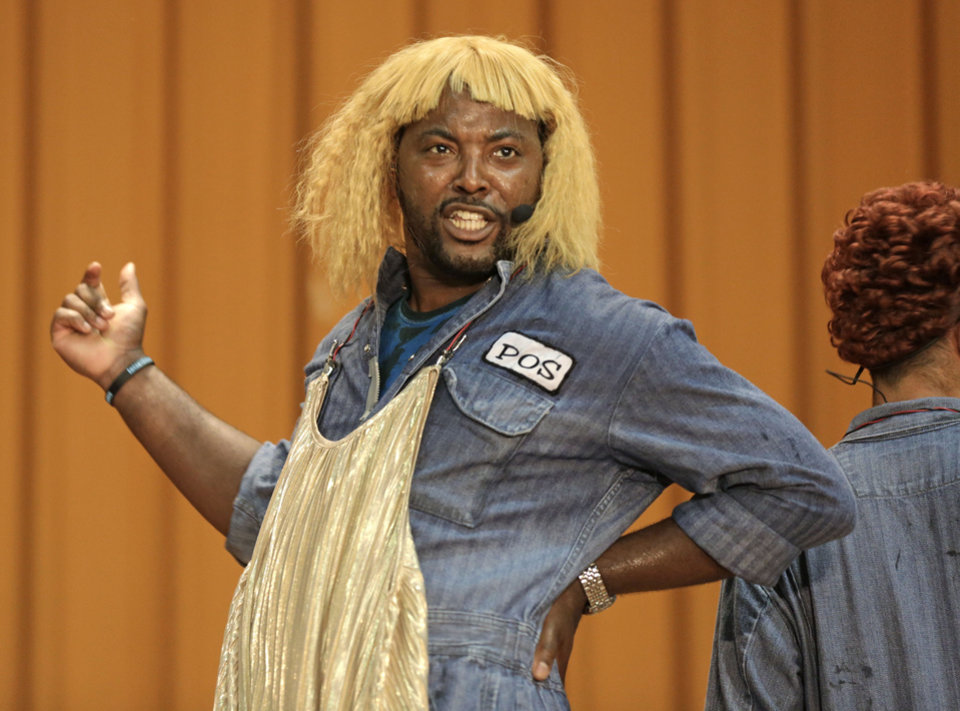 Photo - In this Aug. 27, 2013, photo, rapper Postell Pringle wears a wig as he performs in a hip hop adaptation of William Shakespeare's Othello, titled