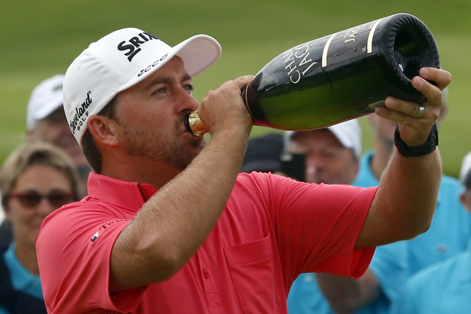 Photo - Graeme McDowell of Northern Ireland drinks champagne after winning the French Open Golf tournament at Paris National course in Guyancourt, west of Paris, France, Sunday, July 6, 2014. (AP Photo/Francois Mori)