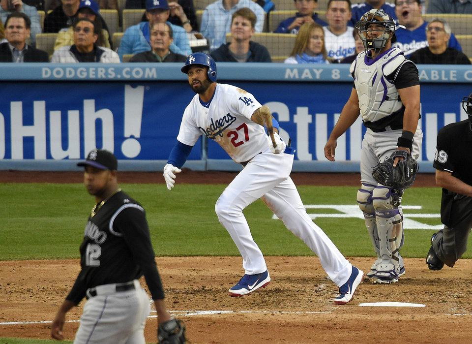 Photo - Los Angeles Dodgers' Matt Kemp, center, watches his solo home, between Colorado Rockies starting pitcher Juan Nicasio, left, and catcher Wilin Rosario during the third inning of a baseball game, Saturday, April 26, 2014, in Los Angeles. (AP Photo/Mark J. Terrill)
