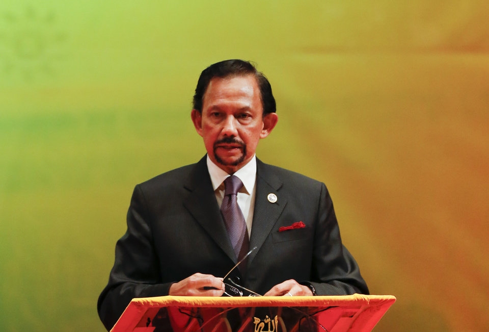 Photo - In this photo taken Thursday, Oct, 10, 2013, Brunei's Sultan Hassanal Bolkiah speaks during the closing ceremony and handover of the ASEAN Chairmanship to Myanmar in Bandar Seri Begawan. Hollywood is responding to harsh new laws in Brunei by boycotting the Beverly Hills Hotel. The Motion Picture & Television Fund joined a growing list of organizations and individuals Monday, May 5, 2014, refusing to do business with hotels owned by the Sultan or government of Brunei to protest the country's new penal code that calls for punishing adultery, abortions and same-sex relationships with flogging and stoning. (AP Photo/Vincent Thian, file)