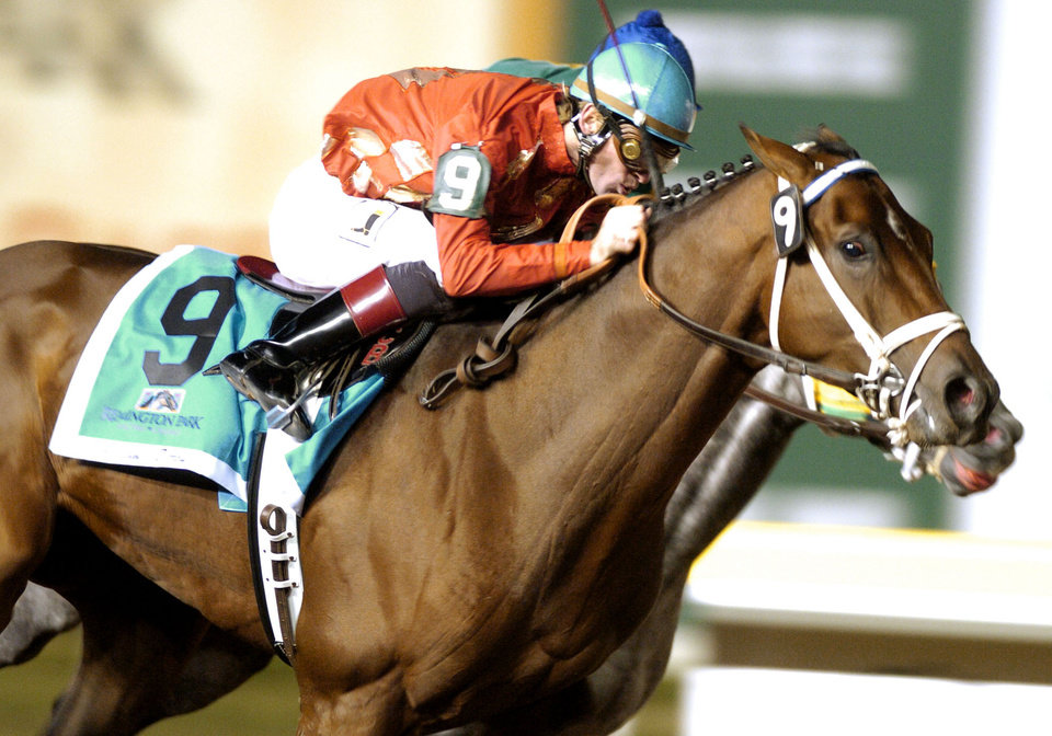 Jockey Cliff Berry, on horse No. 9, Mr. Pursuit, edges out another horse to win the Oklahoma Derby at Remington Park racetrack in Oklahoma City on Friday, October 20, 2006. By Michael Downes, The Oklahoman