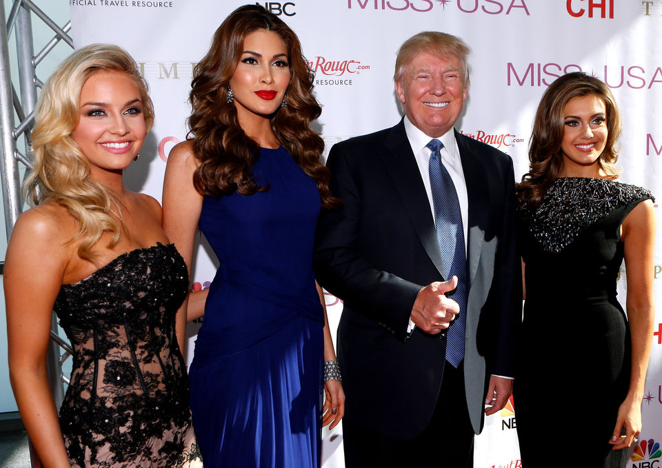 Photo - From left, Miss Teen USA 2013 Cassidy Wolf, Miss Universe 2013 Gabriela Isler, Donald Trump, and Miss USA 2013 Erin Brady pose during a red carpet event before the Miss USA 2014 pageant in Baton Rouge, La., Sunday, June 8, 2014. (AP Photo/Jonathan Bachman)