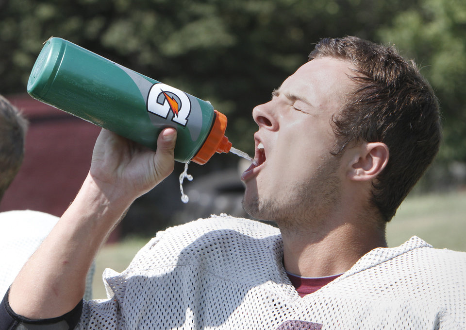 Photo -  WR Peyton Maroney gets a drink  during Cashion's football practice, Monday, August 18, 2014. Photo by David McDaniel, The Oklahoman