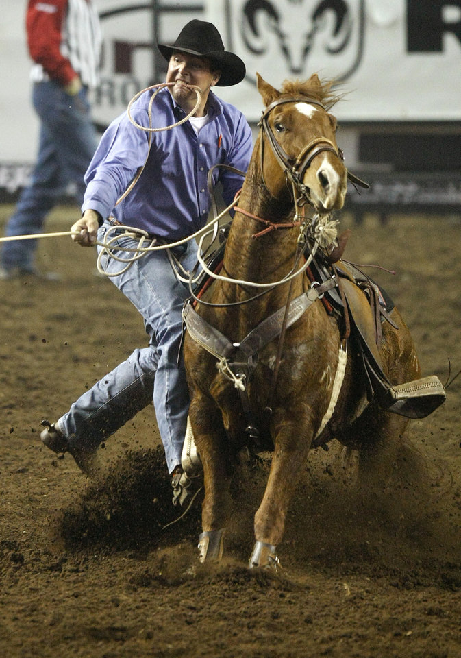 Jerome Schneeberger of Ponca City, Okla., competes in tie-down roping during the National Circuit Finals Rodeo at State Fair Arena in Oklahoma City, Thursday, March 29, 2012. Photo by Bryan Terry, The Oklahoman