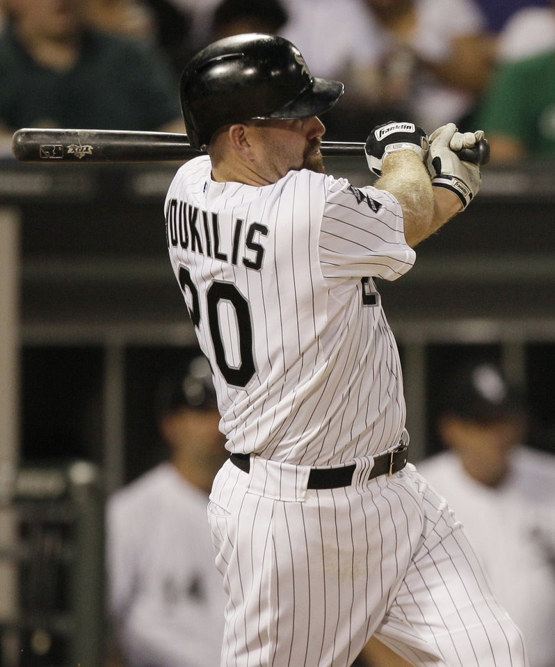 Photo -   Chicago White Sox's Kevin Youkilis follows through on an RBI single against the Toronto Blue Jays during the fifth inning of a baseball game in Chicago, Friday, July 6, 2012. (AP Photo/Sitthixay Ditthavong)