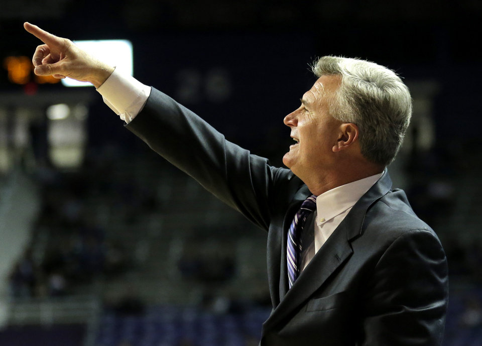Photo - Kansas State coach Bruce Weber instructs his players during the second half of an NCAA college basketball game against South Carolina Upstate Sunday, Dec. 2, 2012, in Manhattan, Kan. Kansas State won the game 72-53. (AP Photo/Charlie Riedel)