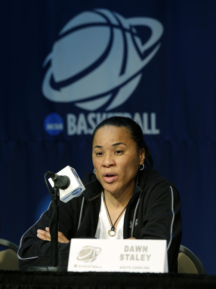 Photo - South Carolina head coach Dawn Staley talks to reporters during a news conference at the NCAA women's college basketball tournament, Saturday, March 22, 2014, in Seattle. South Carolina plays Cal State Northridge in a first-round game on Sunday. (AP Photo/Ted S. Warren)