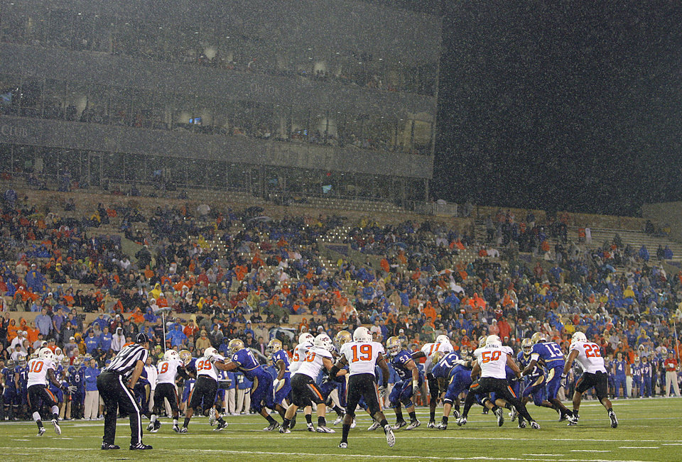 Photo - The rain falls as Oklahoma State takes on Tulsa during a college football game between the Oklahoma State University Cowboys and the University of Tulsa Golden Hurricane at H.A. Chapman Stadium in Tulsa, Okla., Sunday, Sept. 18, 2011. Photo by Chris Landsberger, The Oklahoman