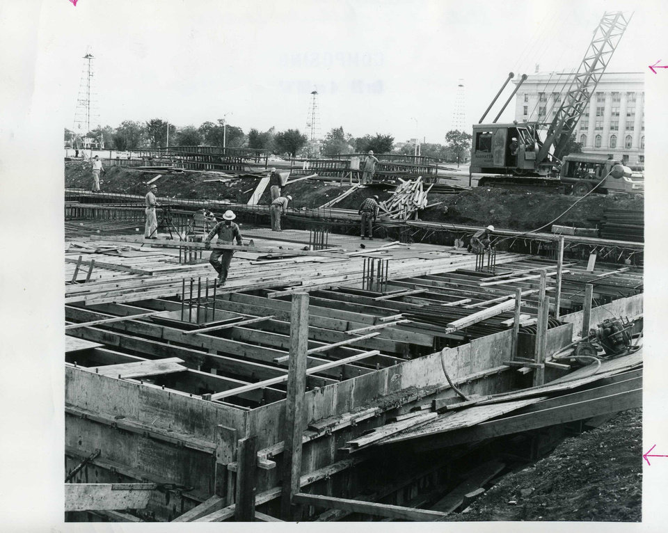 Photo - OKLAHOMA STATE CAPITOL COMPLEX - OFFICE BUILDINGS - NEW FALLOUT SHELTER: Workmen, spurred by current Cuba crisis, lay roofing supports for new government fall-out shelter.  Photographer unknown; OKLAHOMAN ARCHIVES PHOTO (Photo taken Oct. 19, 1962)
