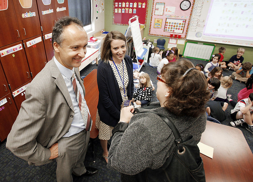 Photo - French Consul General Frederic Bontems talks with Janet Gorton, world language coordinator for Norman Public Schools, while Ronald Reagan Elementary School  kindergarten teacher Claire Allison and her students watch.  PHOTO BY STEVE SISNEY, THE OKLAHOMAN