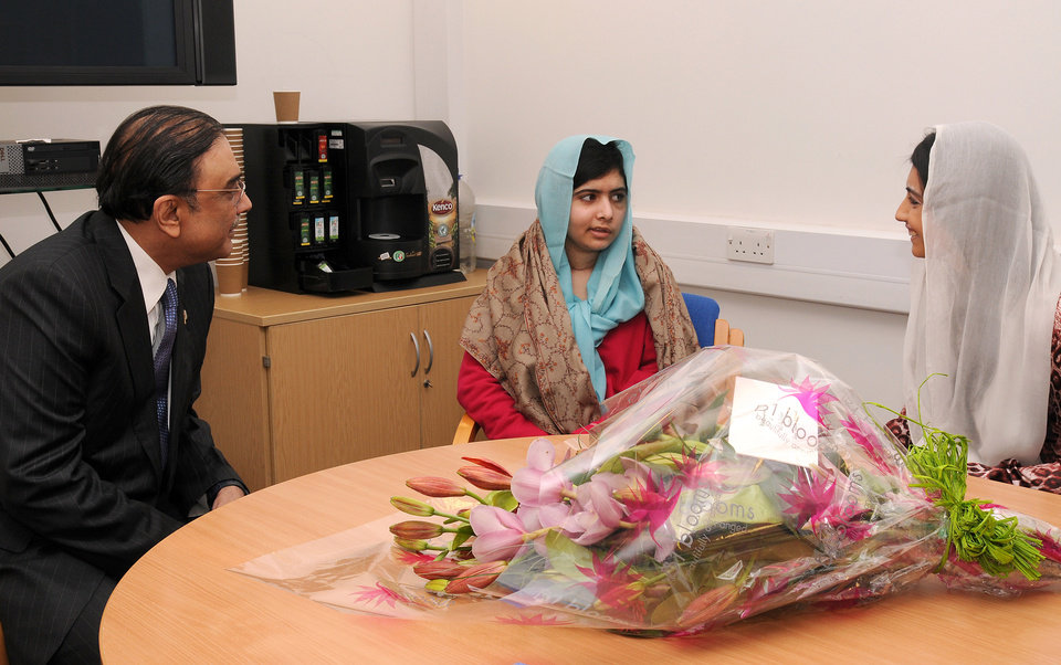 In this photo provided by the Queen Elizabeth Hospital Birmingham, Pakistan's President Asif Ali Zardari, left, and his daughter Asifa Bhutto, right, meet with Malala Yousufzai, where she is undergoing treatment for injuries sustained when a Taliban gunman opened fire on her and her friends outside the Khushal School for Girls in Mingora, Swat Valley, Pakistan, at the Queen Elizabeth Hospital in Birmingham, England, Saturday, Dec. 8, 2012. The Taliban targeted Malala because of her outspoken and relentless objection to the group's regressive interpretation of Islam that keeps women at home and bars girls from school. (AP Photo/Queen Elizabeth Hospital Birmingham)