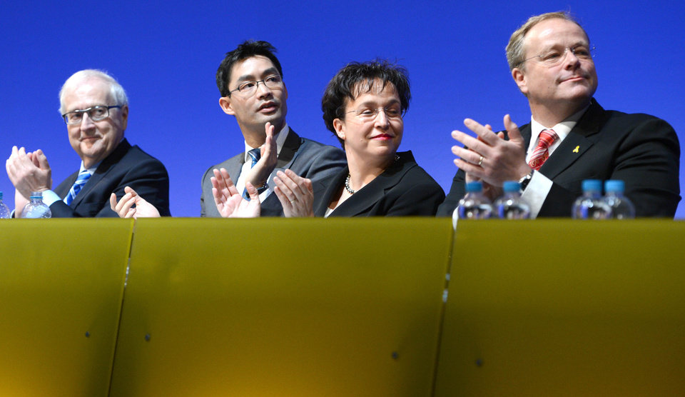 From left: Free Democratic Party (FDP) faction leader Rainer  Bruederle.  German economy minister, vice-chancellor and party chairman,  Philipp Roesler, vice-chairwoman of the party, Birgit Homburger and development minister Dirk Niebel attend a meeting of the FDP in Stuttgart, southern Germany, Sunday, Jan. 6, 2013. Germany's embattled vice chancellor is battling to quell speculation about his leadership of the country's junior governing party, whose dire poll ratings are a complicating factor in Chancellor Angela Merkel's bid for re-election.  Philipp Roesler, who's also Germany's economy minister, appealed to his pro-market Free Democratic Party on Sunday to show unity ahead of a state election in his home region of Lower Saxony on Jan. 20, an important political test ahead of national elections in September.  (AP Photo/dpa/ Bernd Wei�brod)
