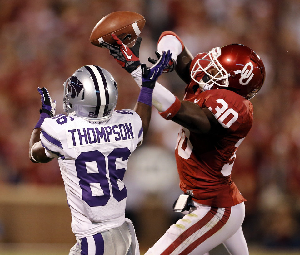 Javon Harris (30) breaks up a pass intended for Tramaine Thompson (86) during the second half of a college football game where the University of Oklahoma Sooners (OU) lost 24-19 to the Kansas State University Wildcats (KSU) at Gaylord Family-Oklahoma Memorial Stadium, Saturday, September 22, 2012. Photo by Steve Sisney, The Oklahoman