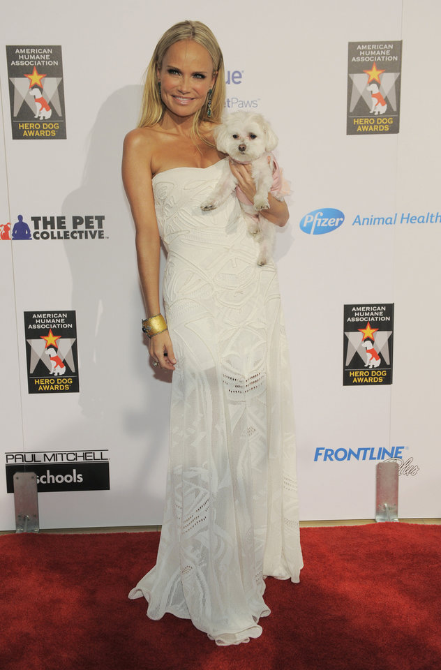 """Host Kristin Chenoweth poses with her dog """"Maddie"""" at the Hero Dog Awards at the Beverly Hilton Hotel on Saturday, Oct. 6, 2012, in Beverly Hills, Calif. The event honored America\'s most courageous canines. (Photo by Chris Pizzello/Invision/AP) ORG XMIT: NYENT106"""