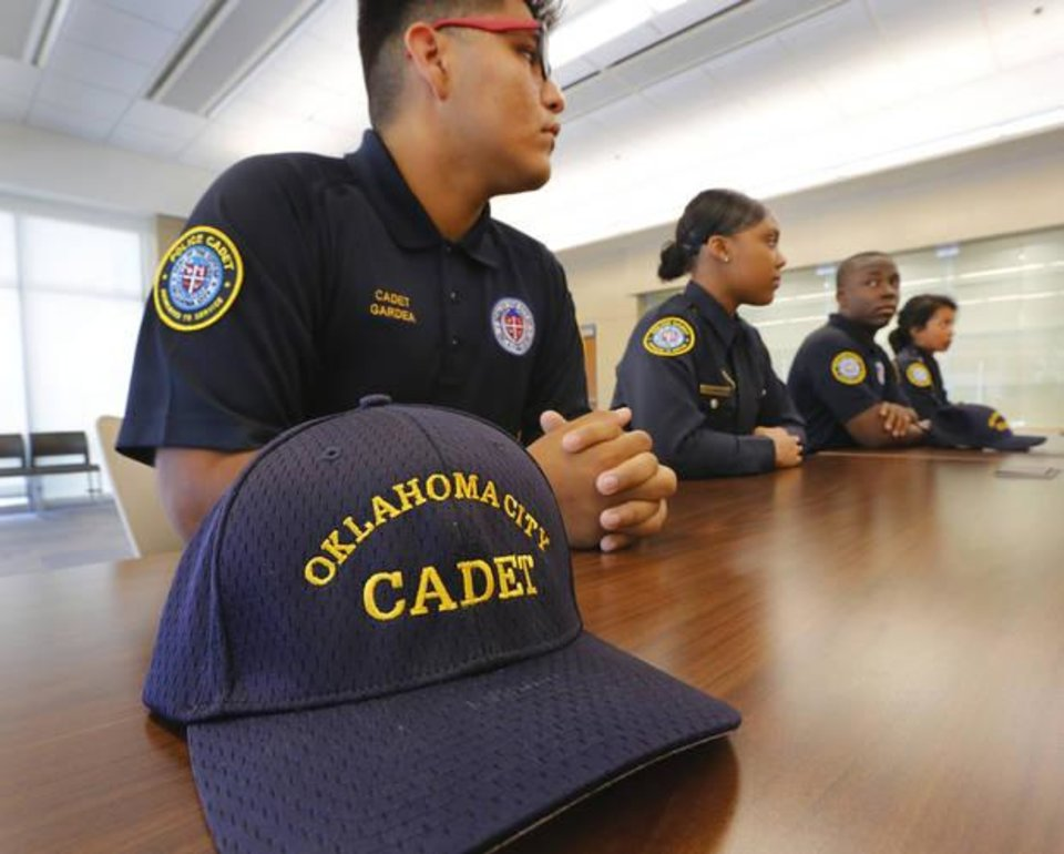 Photo -  Some of the members of the current OCPD Cadet Class. From left, Cadet Jairo Gardea, Cadet D'Angella Hunter, Cadet Jimmy Reece and Cadet Zara Triana at the Oklahoma City Police Department on Wednesday, June 22, 2016. [Photo by Jim Beckel, The Oklahoman]