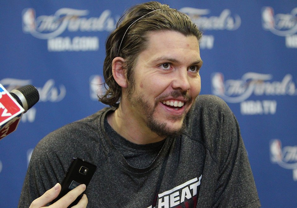 Photo - Miami Heat forward Mike Miller speaks with reporters at NBA basketball practice, Saturday, June 15, 2013, in San Antonio. The Heat take on the San Antonio Spurs in Game 5 of the NBA Finals on Sunday, with the best-of-seven games series even at 2-2.(AP Photo/El Nuevo Herald, David Santiago)  MAGS OUT