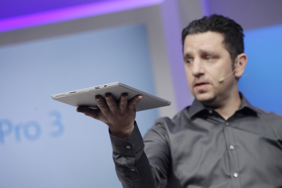 Photo - Panos Panay, Microsoft's vice president for surface computing, introduces the Surface Pro 3 tablet device at a media preview, Tuesday, May 20, 2014 in New York. The device will have a screen measuring 12 inches diagonally, up from 10.6 inches in previous models. Microsoft says it's also thinner and faster than before.  (AP Photo/Mark Lennihan)