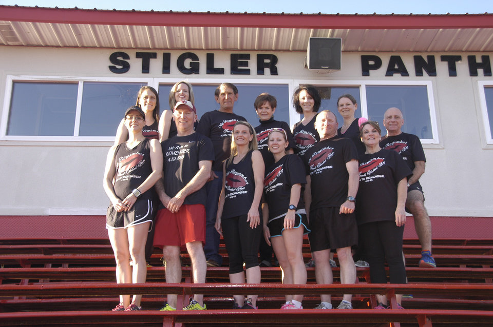 Photo -  Billy and Joyce Cleveland (second row, middle) pose with some of the runners from Stigler who participate in the Oklahoma City Memorial Marathon in memory of the Clevelands' daughter, Pam Argo. PHOTO PROVIDED    Photo provided