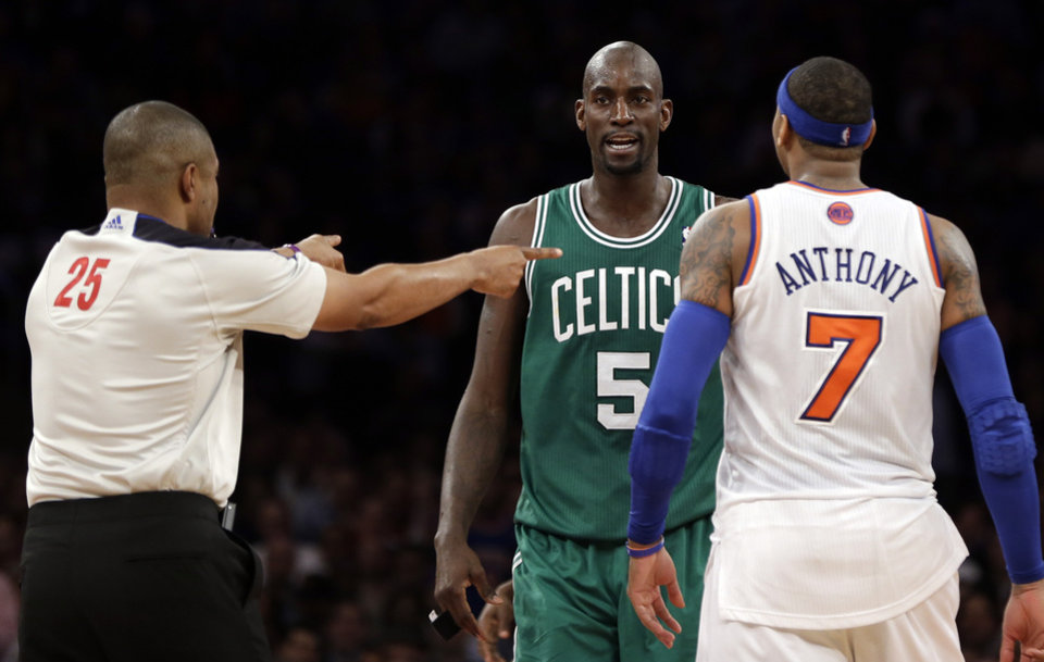 Photo - In this photo taken Monday, Jan. 7, 2013, referee Tony Brothers, left, issues technical fouls to New York Knicks' Carmelo Anthony and Boston Celtics' Kevin Garnett during the second half of an NBA basketball game at Madison Square Garden in New York. The All-Star forwards exchanged words during the game and Anthony clearly was affected. He said Tuesday he lost his cool after Garnett said things to him that he feels shouldn't be said to