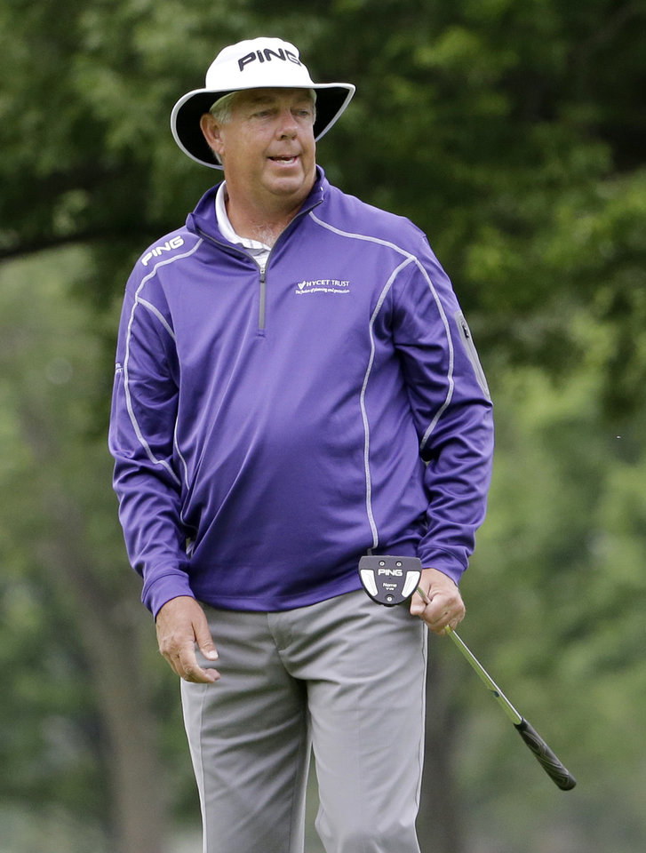Photo - Kirk Triplett reacts after missing a birdie putt on the 17th green during the second round of the Encompass Championship golf tournament in Glenview, Ill., Saturday, June 21, 2014. (AP Photo/Nam Y. Huh)