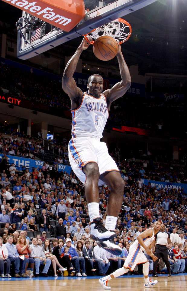 Photo - Oklahoma City's Kendrick Perkins (5) dunks the ball during the NBA basketball game between the Oklahoma City Thunder and the Minnesota Timberwolves at Chesapeake Energy Arena in Oklahoma City, Friday, March 23, 2012. Photo by Bryan Terry, The Oklahoman