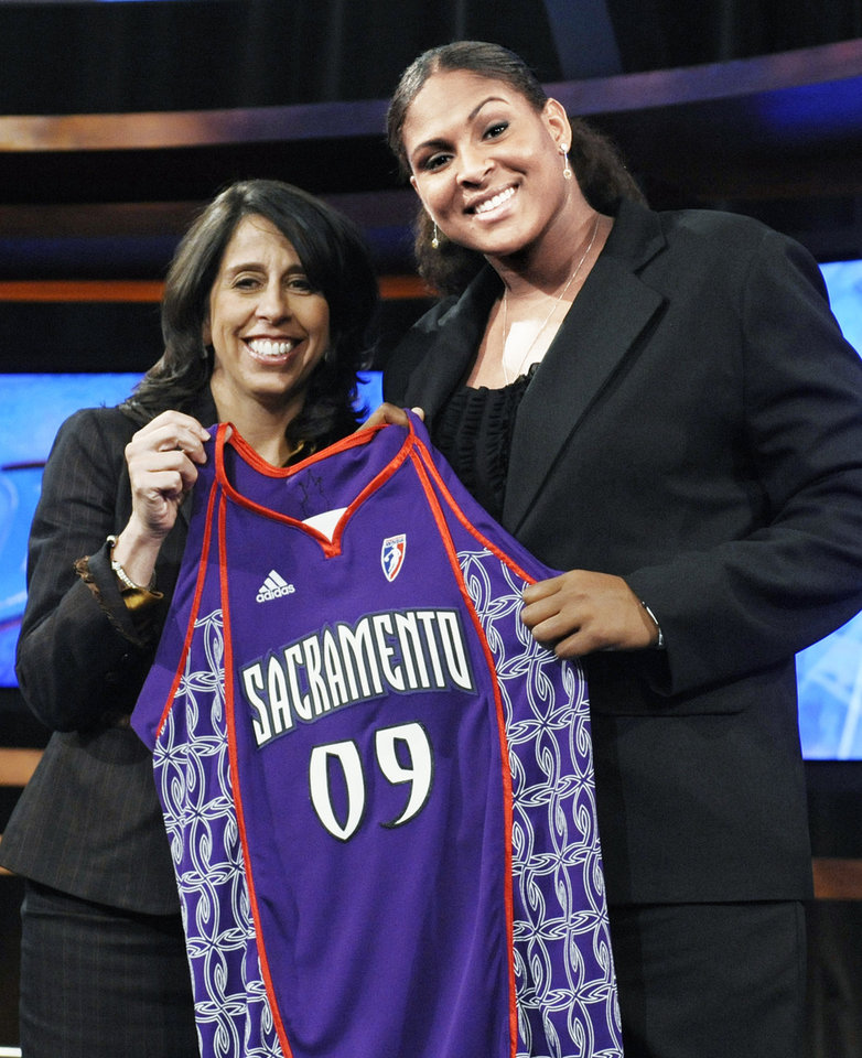 Photo - Oklahoma's Courtney Paris, right, holds up a Sacramento Monarchs jersey as she poses with WNBA president Donna Orender after Paris was chosen as the seventh pick overall in the WNBA basketball draft, Thursday, April 9, 2009, in Secaucus, N.J. (AP Photo/Bill Kostroun) ORG XMIT: NJBK107