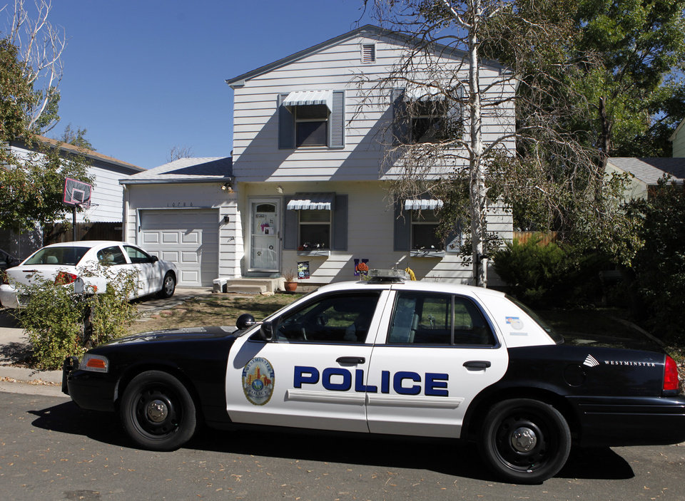 Photo -   A Westminster police officer sits in her partrol car at the home of ten-year-old Jessica Ridgeway in Westminster, Colo., on Monday, Oct. 8, 2012. The youngster has been missing since she left her home Friday morning on her way to school. (AP Photo/Ed Andrieski)