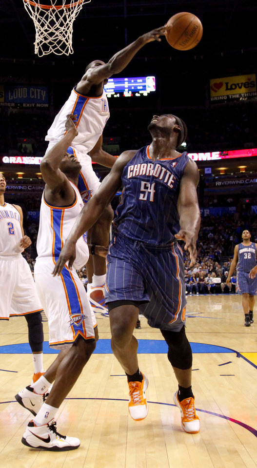 Photo - Oklahoma City's Nazr Mohammed, bottom, and Serge Ibaka defend Charlotte's Kwame Brown during the NBA basketball game between the Oklahoma City Thunder and the Charlotte Bobcats at the Oklahoma City Arena, Friday, March 18, 2011. Photo by Bryan Terry, The Oklahoman