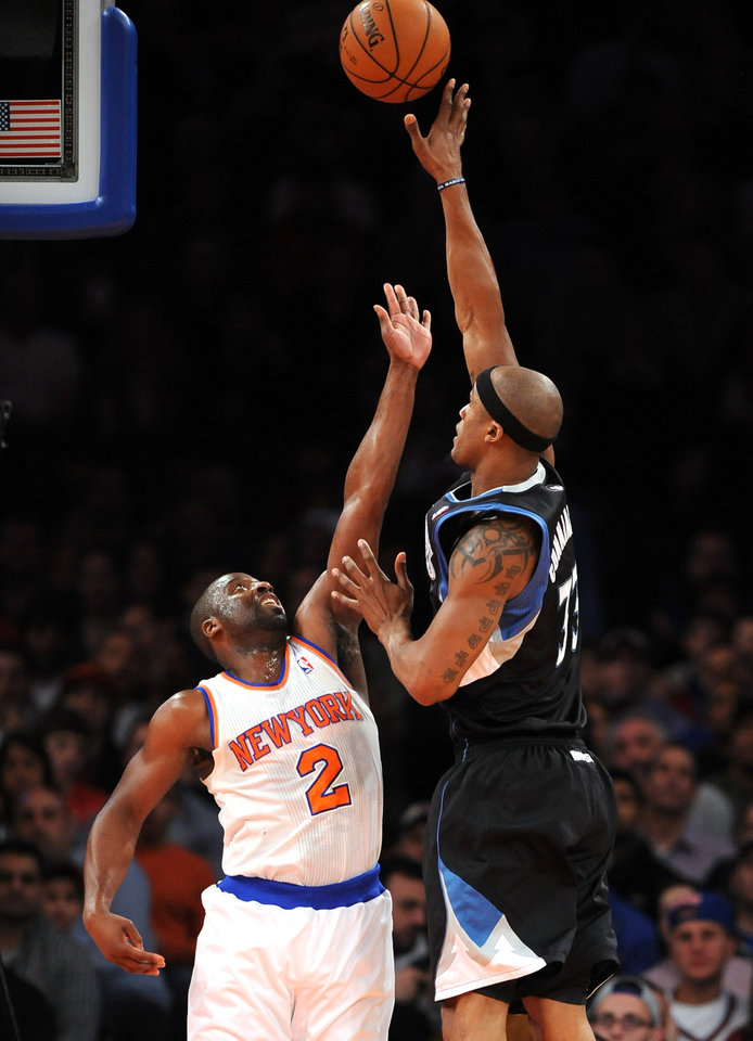 Minnesota Timberwolves' Dante Cunningham (33) shoots over New York Knicks' Raymond Felton (2) in the first half of an NBA basketball game on Sunday, Dec., 23, 2012, at Madison Square Garden in New York. (AP Photo/Kathy Kmonicek)
