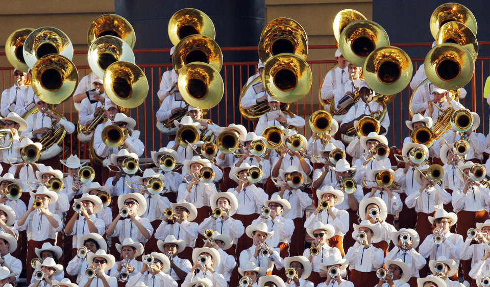 Photo - Members of the Texas band play in the stands during the second half of a college football game between the Oklahoma State University Cowboys (OSU) and the University of Texas Longhorns (UT) at Darrell K Royal-Texas Memorial Stadium in Austin, Texas, Saturday, Oct. 15, 2011. OSU won, 38-26. Photo by Nate Billings, The Oklahoman