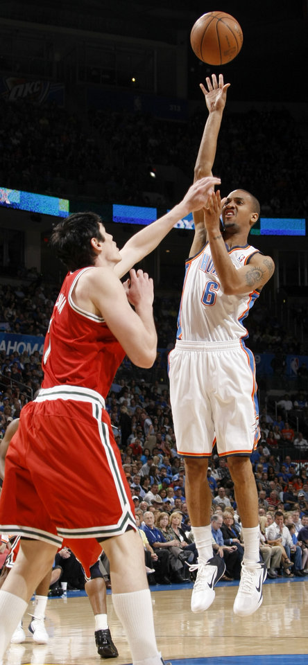 Photo - Oklahoma City's Eric Maynor (6) shoots the ball over Milwaukee's Ersan Ilyasova (7) during the NBA basketball game between the Oklahoma City Thunder and the Milwaukee Bucks at the Oklahoma City Arena, Wednesday, April 13, 2011. Photo by Bryan Terry, The Oklahoman