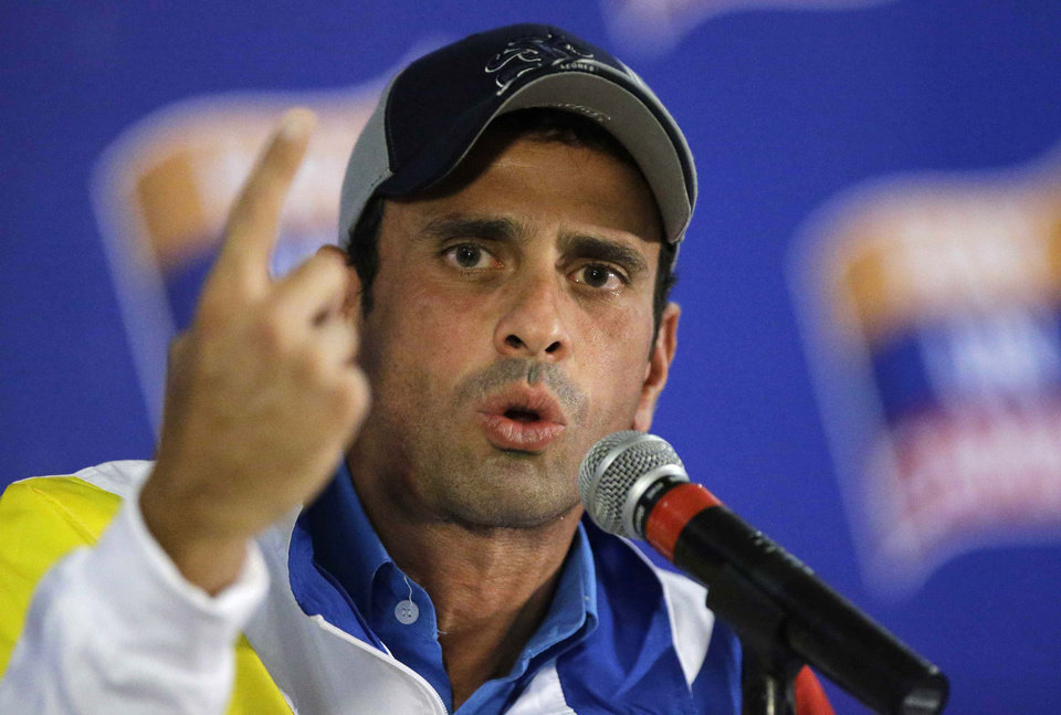 Photo -   Former opposition presidential candidate Henrique Capriles speaks during a news conference in Caracas, Venezuela, Tuesday, Oct. 9, 2012. Capriles defended a parking lot-sized goal on the downhill half while President Hugo Chavez's team manned a pixie goal on the uphill side. (AP Photo/Fernando Llano)
