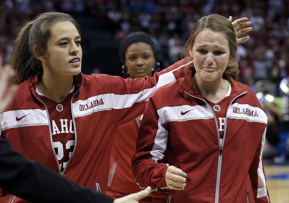 Oklahoma's Maddie Manning (23) and Whitney Hand react after losing to Tennessee at the  Oklahoma City Regional for the NCAA women's college basketball tournament at Chesapeake Energy Arena in Oklahoma City, Sunday, March 31, 2013. Photo by Sarah Phipps, The Oklahoman