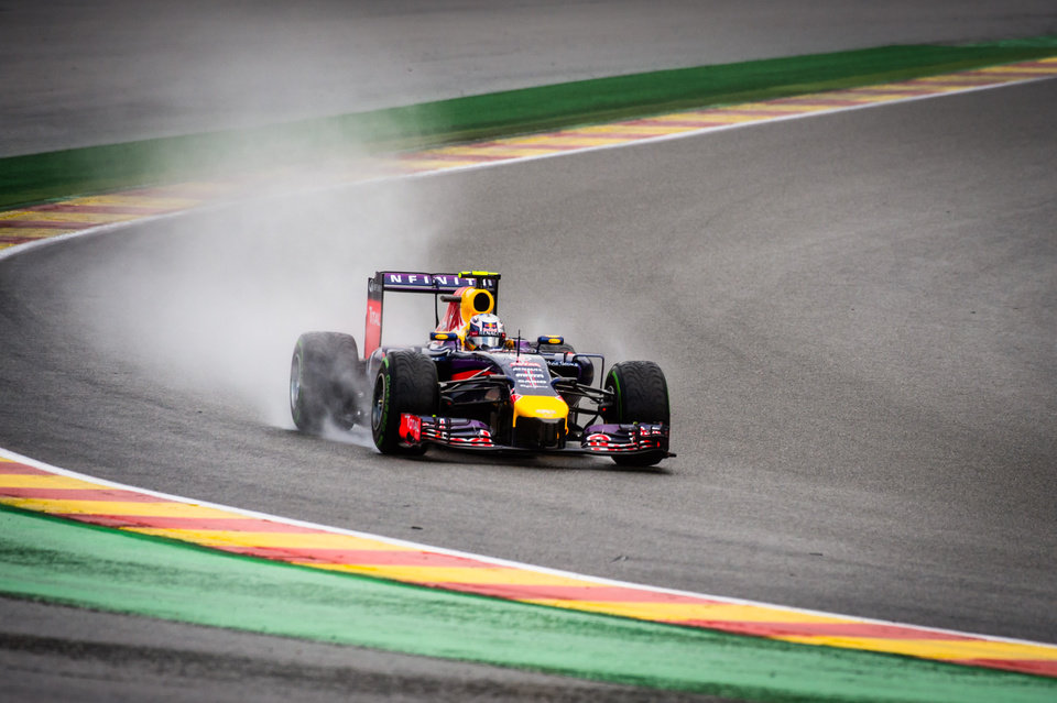 Photo - Red Bull driver Sebastian Vettel of Germany steers his car during the qualifying session ahead of Sunday's Belgian Formula One Grand Prix in Spa-Francorchamps, Belgium, Saturday, Aug. 23, 2014. Mercedes driver Nico Rosberg of Germany starts on pole position, Mercedes driver Lewis Hamilton of Britain placed second and Red Bull driver Sebastian Vettel of Germany third. (AP Photo/Geert Vanden Wijngaert)