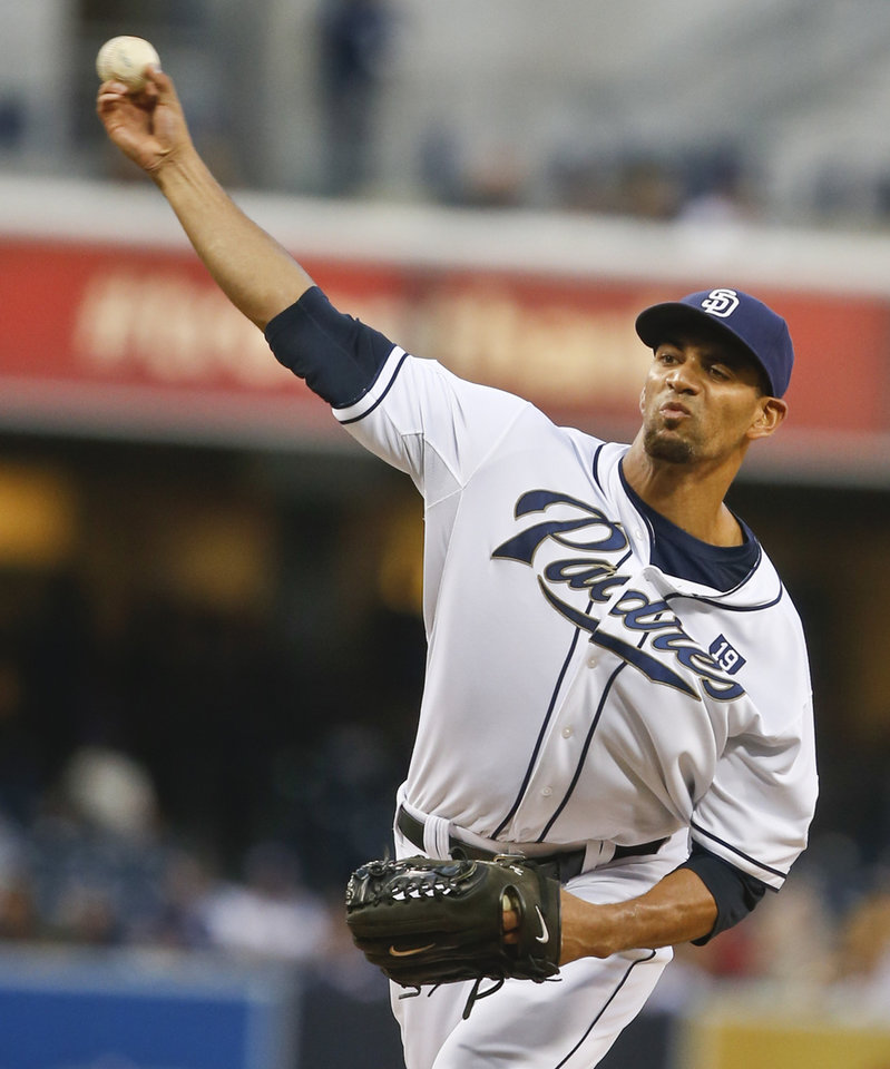 Photo - San Diego Padres starting pitcher Tyson Ross pitches to the Milwaukee Brewers in the first inning of a baseball game Tuesday, Aug. 26, 2014, in San Diego.  (AP Photo/Lenny Ignelzi)
