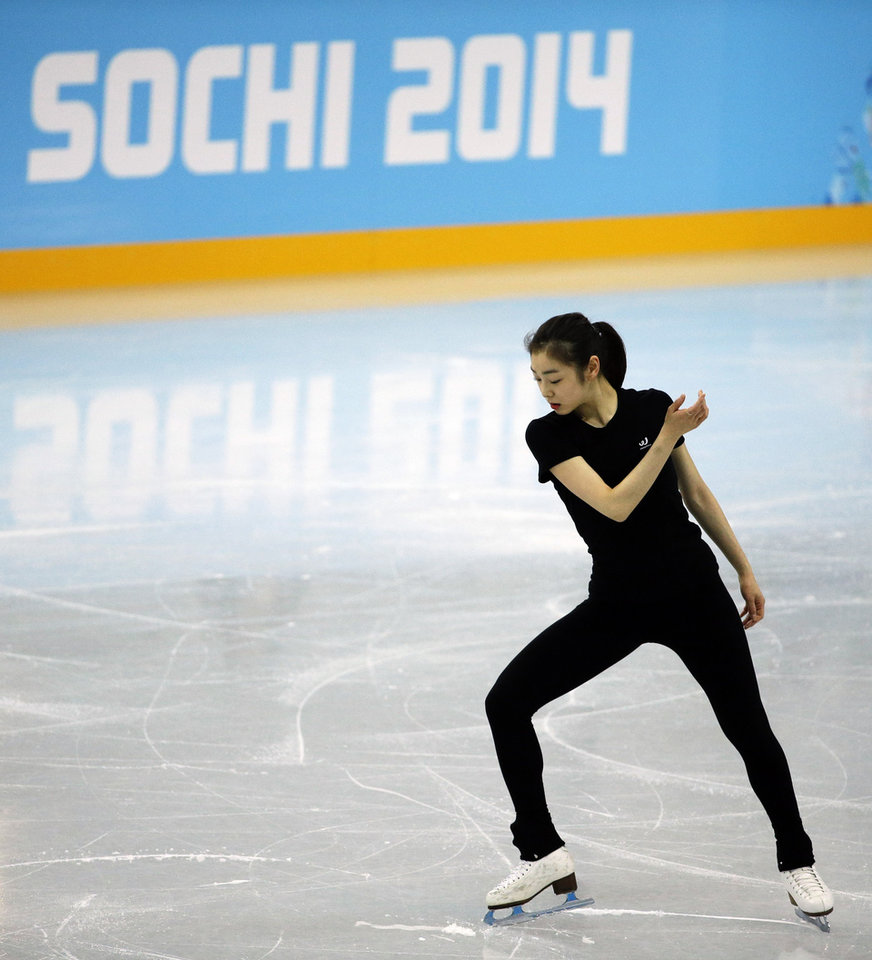 Photo - Yuna Kim of South Korea performs during the practice session at Iceberg Skating Palace at the 2014 Winter Olympics, Tuesday, Feb. 18, 2014, in Sochi, Russia. (AP Photo/David Goldman)