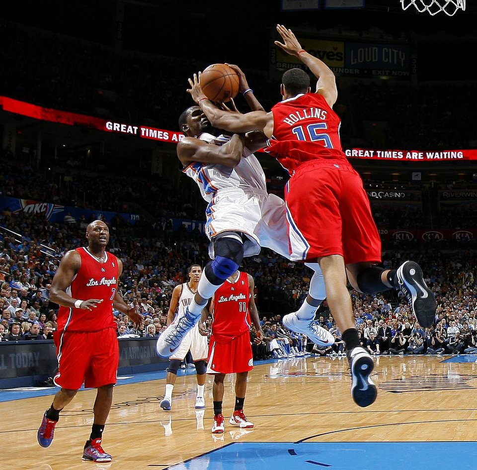Photo - Oklahoma City's Kevin Durant (35) is fouled by the Clippers Ryan Hollins (15) during an NBA basketball game between the Oklahoma City Thunder and the Los Angeles Clippers at Chesapeake Energy Arena in Oklahoma City, Wednesday, Nov. 21, 2012. Photo by Bryan Terry, The Oklahoman