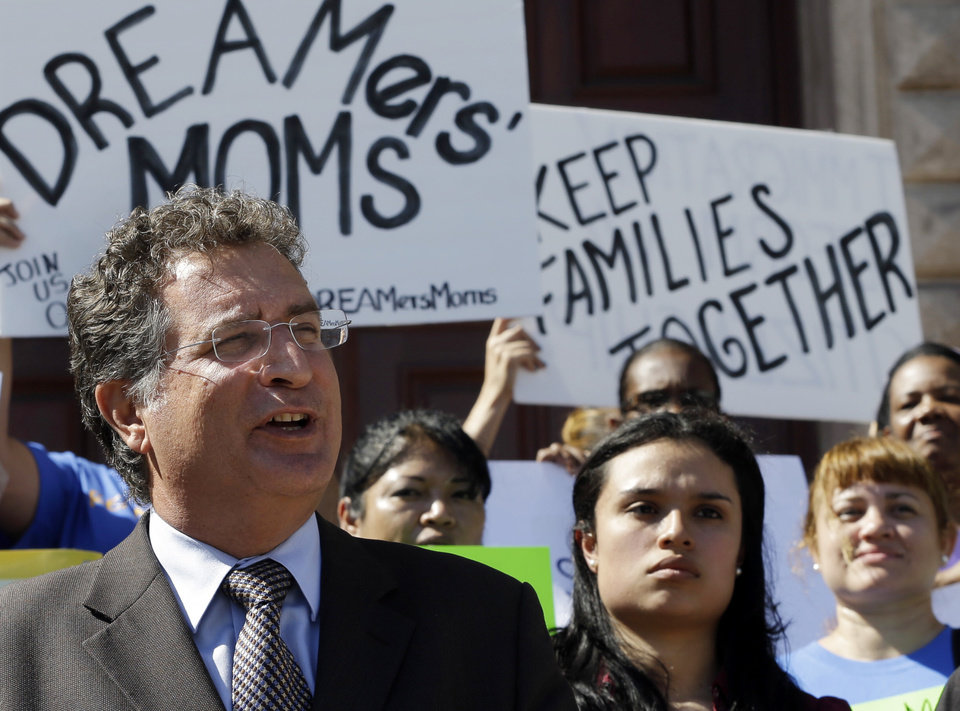 Photo - Rep. Joe Garcia, D-Fla, states his support for immigrants and pledges to work in favor of immigration reform to reporters as immigration reform activists protest in front of Freedom Tower in downtown Miami, Monday, Jan. 28, 2013. The Florida Immigrant Coalition, together with other immigrant families and community organizations, have initiated the