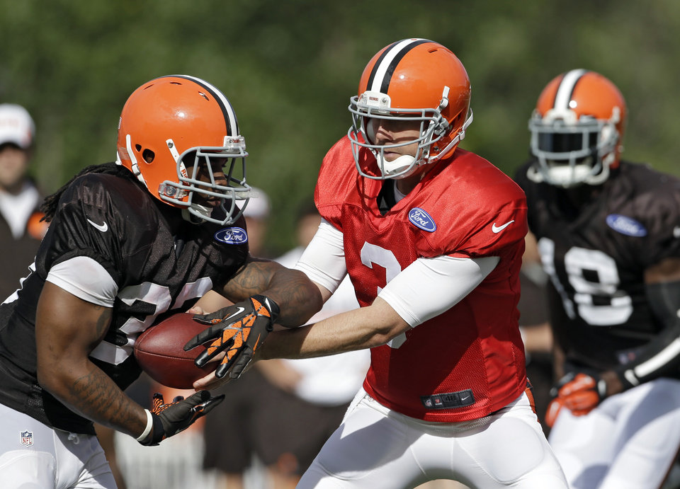Brandon Weeden has a new coaching staff and a new GM in Cleveland, but he doesn't have much in the way of more help on the field. The former Oklahoma State standout will get his turn running Norv Turner's offense, though. Might that be enough to turn the Browns around? (AP Photo/Mark Duncan)