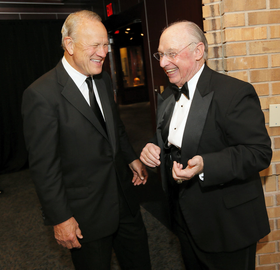 Photo - Barry Switzer, left, and Pat Jones,  2012 inductee to the Oklahoma Sports Hall of Fame, share a laugh at a gathering at the Oklahoma Sports Hall of Fame before the induction ceremony in Oklahoma City, Monday, Aug. 6, 2012. Switzer gave Jones' introduction at the ceremony. Photo by Nate Billings, The Oklahoman
