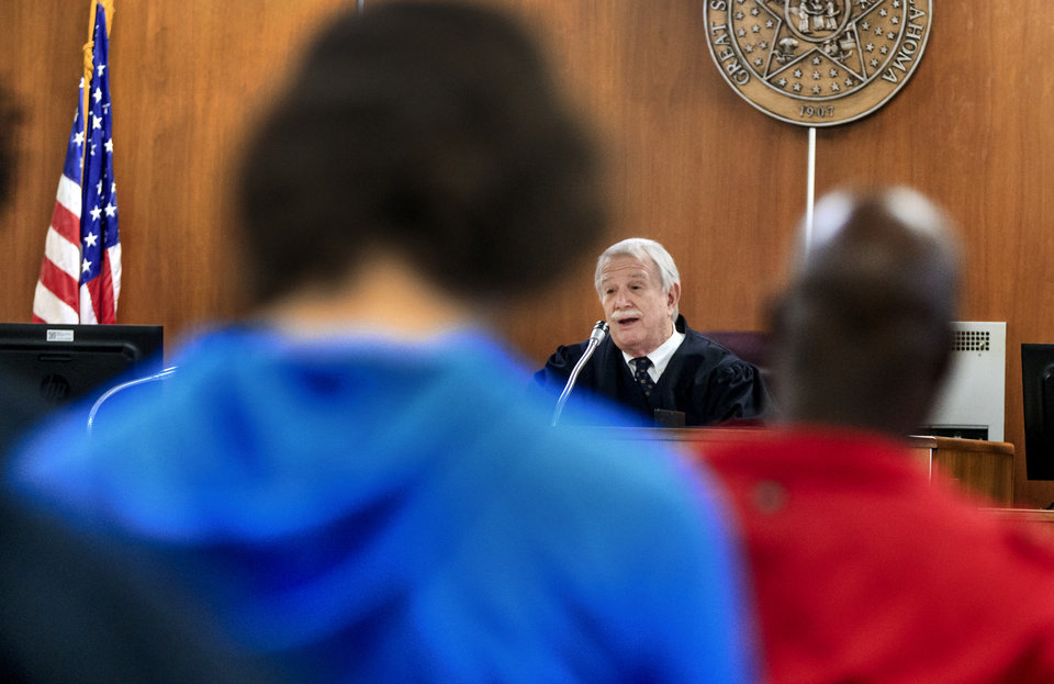 Photo -  Oklahoma County Special Judge James Croy instructs defendants about how to resolve their traffic cases. [Photo by Chris Landsberger, The Oklahoman]