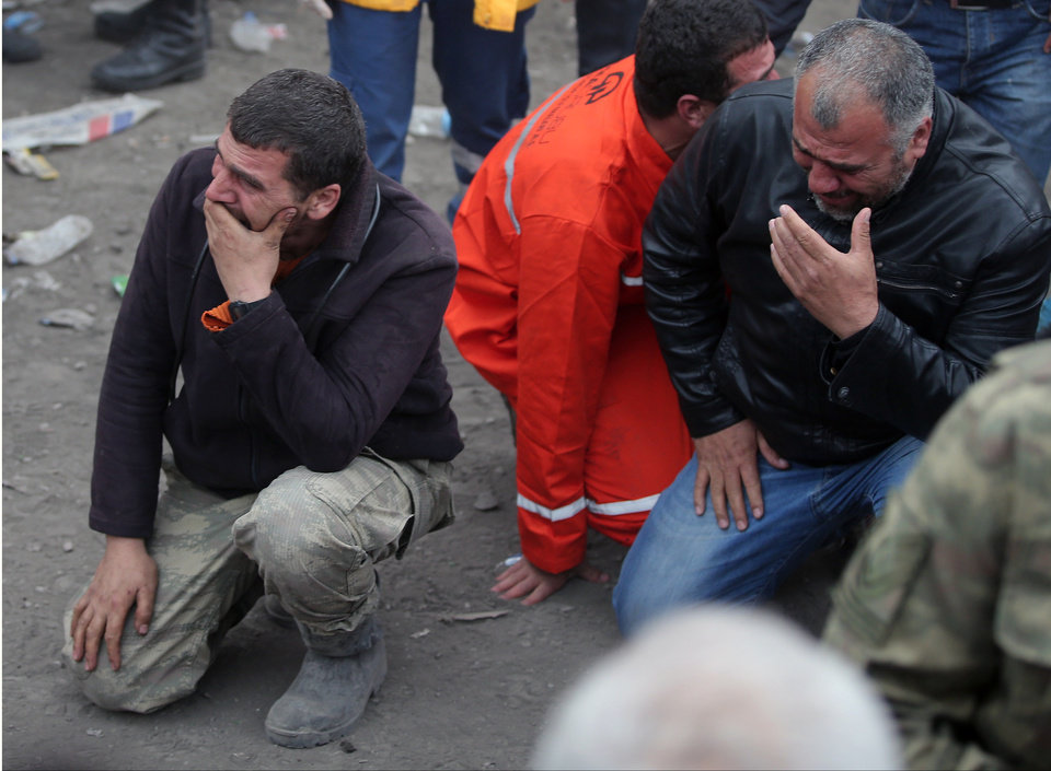 Photo - Family members, react, as they wait outside the mine in Soma, western Turkey, Wednesday, May 14, 2014. Rescuers desperately raced against time to reach more than 200 miners trapped underground Wednesday after an explosion and fire at a coal mine in western Turkey killed at least 200 workers, authorities said, in one of the worst mining disasters in Turkish history. Turkey's Energy Minister Taner Yildiz said 787 people were inside the coal mine in Soma, some 250 kilometers (155 miles) south of Istanbul, at the time of the accident and 363 of them had been rescued so far. (AP Photo/Emrah Gurel)