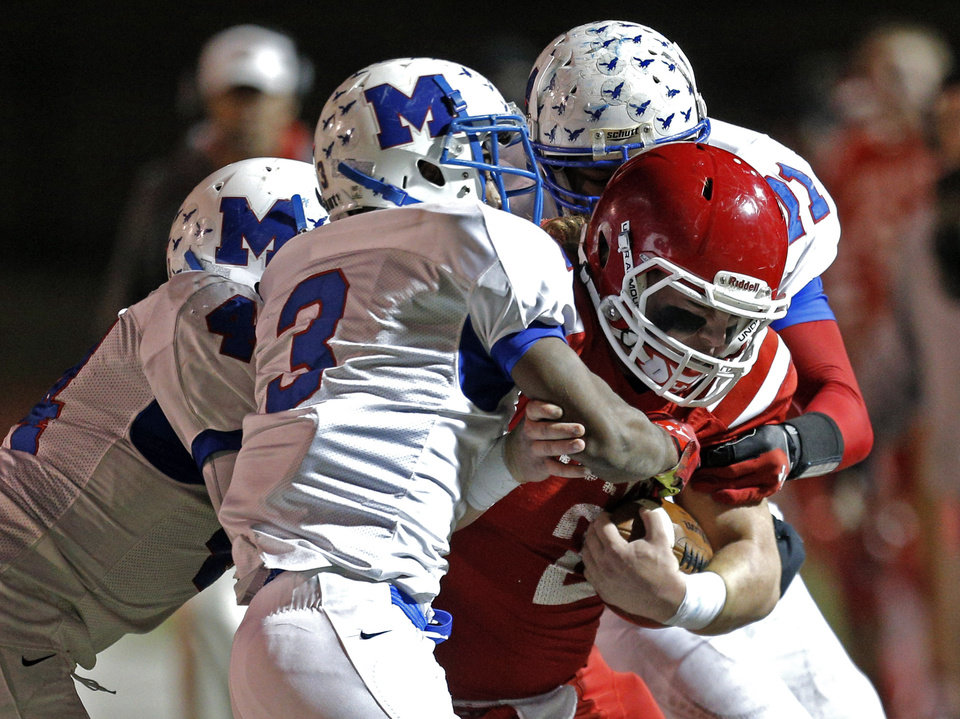 Photo - A trio of Millwood defenders bring down Braden Ruth during the Class 2A state football championship game between Davis and Millwood at Moore High School in Moore, Okla.,  Thursday, Dec. 19, 2013. Photo by Sarah Phipps, The Oklahoman